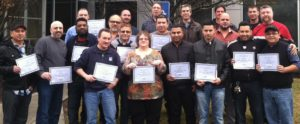 Green belt lean manufacturing participants proudly display their certificates